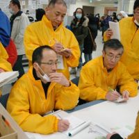 Heart to heart: A trauma team from Ishikawa Prefecture that treats people with posttraumatic stress disorder consults an evacuee at Ishinomaki City Hall, Miyagi Prefecture, on April 12. | KYODO PHOTO