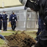 Scraping the surface: Workers remove topsoil from a nursery school playground Wednesday in Koriyama, Fukushima Prefecture. | KYODO