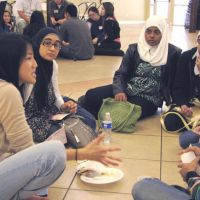Volunteer spirit: Tracy Kato-Kiriyama (left) talks with students at a meeting of the Bridging Communities Program held at the West Coast Islamic Society in Anaheim, California, in March. | KYODO