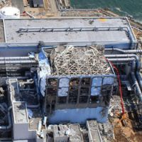 Aftermath: A photo taken by a small unmanned aerial vehicle and released by Air Photo Service shows the damaged No. 4 reactor building at the Fukushima No. 1 power plant in Okuma, Fukushima Prefecture. | AP