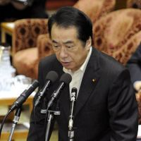 On schedule: Prime Minister Naoto Kan speaks during a Diet committee meeting Monday. | KYODO PHOTO