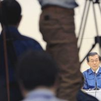 Under the microscope: Tokyo Electric Power Co. President Masataka Shimizu attends a news conference at the company's headquarters on April 15. | AP PHOTO