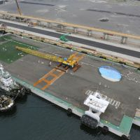 Finally there: After being towed for weeks from Shizuoka, a 'megafloat' docks at Onahama port in Iwaki, Fukushima Prefecture, on Tuesday. The huge container will be used to store irradiated water from the Fukushima No. 1 nuclear plant. | KYODO