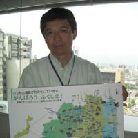 Hard sell: Masaru Saga, director of Fukushima Prefecture's tourism promotion division, holds a map showing noted tourist destinations not affected by the nuclear crisis.   JUN HONGO