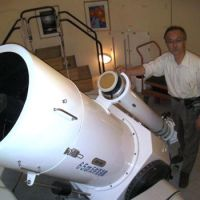 Looking on the bright side: Hiroaki Ohno, director of the Hoshi no Mura Observatory in Tamura, Fukushima Prefecture, poses May 21 with a telescope that was wrecked by the March 11 earthquake. | JUN HONGO PHOTO