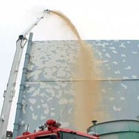 Dust busters: Video grabs by Tokyo Electric Power Co. June 1 show a firetruck spraying dust inhibitor onto reactor 2 at the Fukushima No. 1 nuclear plant while workers prepare for the operation. | TEPCO / KYODO