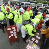 Stepping up: People sign up for volunteer work in Miyako, Iwate Prefecture, on June 1.   KYODO