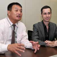 Chopper aid: Koji Hashimoto (left), head of Helicopter Conference of Japan, and member Chris Glenn talk about supplying disaster-hit areas during an interview in Tokyo on June 8. | YOSHIAKI MIURA