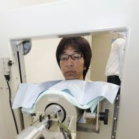 Exposure check: A worker at the National Institute of Radiological Sciences in the city of Chiba undergoes a thyroid radiation exposure checkup Monday. Residents of Fukushima Prefecture are now set to undergo similar exams. | KYODO PHOTO