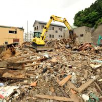 Heavy lifting: A power shovel clears debris from a residential area in Kamaishi, Iwate Prefecture, in May. | YOSHIAKI MIURA