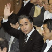 Fresh face: Newly appointed reconstruction minister Tatsuo Hirano raises his hand during a Lower House Budget Committee meeting Wednesday. | KYODO