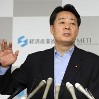 Drawing fire: Industry minister Banri Kaieda holds a news conference in Tokyo on Friday. | KYODO