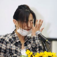 Emotive issue: A woman breaks into tears while calling for children to be protected from radiation exposure during a rally in the city of Fukushima on June 11. | KYODO