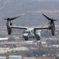 Air show: A tilt-rotor Bell-Boeing MV-22 Osprey flies over U.S. Marine Corps Air Station Miramar in San Diego in June. | KYODO PHOTO