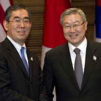 Smooth sailing: Foreign Minister Takeaki Matsumoto (left) and South Korean counterpart Kim Sung Hwan pose during the Association of Southeast Asian Nations Regional Forum in Nusa Dua, Indonesia, on Saturday. | AP