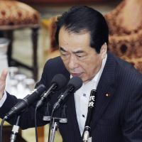 Still standing: Prime Minister Naoto Kan speaks during a session of the Lower House special committee on disaster reconstruction. | KYODO