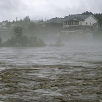 Over the banks: The Agano River rises Friday in Aga, Niigata Prefecture, prompting local governments to urge evacuations. | KYODO PHOTO