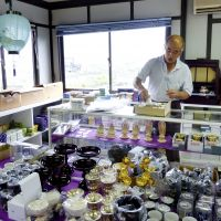 Meeting a need: Tomoji Usuzawa sorts out articles for Buddhist altars in his makeshift store in Otsuchi, Iwate Prefecture, on July 27. | KYODO