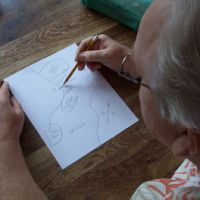 Dig here: In this photo taken in July, a 61-year-old U.S. veteran draws a map of the location on Okinawa where he alleges dozens of barrels of Agent Orange were buried in 1969. | JOE SIPALA