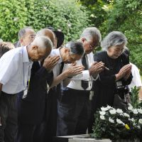 For the fallen: People pray for the war dead Monday at Tokyo's Chidorigafuchi National Cemetery, where the remains of unknown soldiers and civilians who died overseas during the war are buried. | KYODO PHOTO