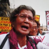 Speaking out: Virginia Vielaruma, 80, a former sex slave of Japanese forces occupying the Philippines during the war, demonstrates with other victims in Manila on Aug. 11. She appears in the documentary 'Katarungan! Justice for Lolas!' | COURTESY OF CHIEKO TAKEMI/KYODO
