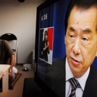 In flux: An evacuee from Naraha, near the crippled nuclear plant in Fukushima Prefecture, watches Prime Minister Naoto Kan's resignation speech on TV Friday at a temporary dwelling.   KYODO PHOTO