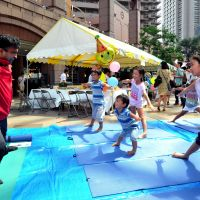 Having fun: Children mimic their instructor at a yoga workshop offered by the Indian Embassy at Children's International Festa 2011 on Sunday at Yebisu Garden Place in Tokyo's Shibuya Ward. | YOSHIAKI MIURA