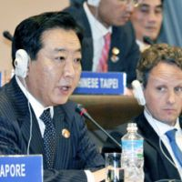 As finance minister, Noda faces reporters last November after the Asia-Pacific Economic Cooperation forum finance ministers' meeting ended in Kyoto, as U.S. Treasury Secretary Timothy Geithner looks on. | KYODO