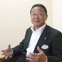Of mice and men: Kyoichiro Uenishi, president of Oriental Land Co., which operates Tokyo Disneyland and Tokyo DisneySea, is interviewed recently in Urayasu, Chiba Prefecture. | KYODO PHOTO