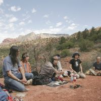 Meeting of minds: Ainu Yasuko Yamamichi (center in front of fire), prays with Native Americans in Arizona in 2006.   KYODO/COURTESY OF MAKIKO UI