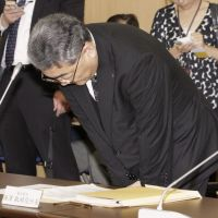 Apology: Tokyo Electric Power Co. President Toshio Nishizawa bows during a government panel meeting Tuesday. | KYODO