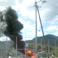 Smoke alarm: A helicopter catches fire Thursday after making an emergency landing in Higashikagawa, Kagawa Prefecture. | KYODO PHOTO