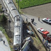 Timetable disruption: Cleanup crews work to clear the wreckage of a train and the truck it hit at a crossing Tuesday on the Chichibu Railway line in Nagatoro, Saitama Prefecture. | KYODO