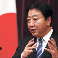 Taking the plunge: Prime Minister Yoshihiko Noda holds a news conference Friday evening in Tokyo to announce that Japan will participate in the Trans-Pacific Partnership negotiations. | AP
