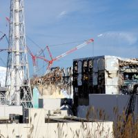 Skeletal wreckage: Damaged reactor buildings stand twisted and silent Saturday at the Fukushima No. 1 nuclear power plant in Okuma, Fukushima Prefecture. | KYODO