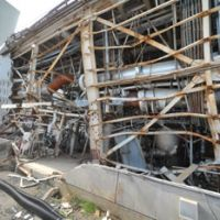 Atomic aftermath: Part of the Fukushima No. 1 nuclear plant is seen Saturday in Okuma, Fukushima Prefecture, as reporters were given access to the facility for the first time since it was wrecked by the March 11 disasters. | POOL