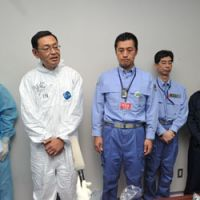 The power plant's general manager, Masao Yoshida (front left) speaks to reporters as he stands next to Goshi Hosono, state minister in charge of the nuclear crisis, at the plant's compound on Saturday. | POOL
