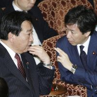 In talks: Prime Minister Yoshihiko Noda speaks Tuesday with Finance Minister Jun Azumi during an Upper House Budget Committee meeting where he faced questions over his stance on the Trans-Pacific Partnership. | KYODO