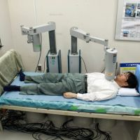 Exposure within: A man demonstrates in late May the use of a whole body counter to gauge internal exposure to radiation at the National Institute of Radiological Science in Chiba Prefecture. | KYODO