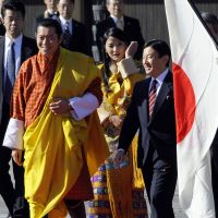 Royal welcome: Bhutan's King Jigme Khesar Namgyal Wangchuck and Queen Jetsun Pema walk with Crown Prince Naruhito during a welcoming ceremony at the Imperial Palace on Wednesday. | AP PHOTO
