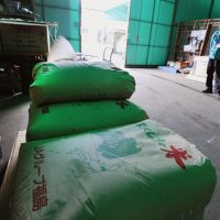 Not marketable: Bags of rice grown in the city of Fukushima and contaminated with radioactive cesium exceeding the government limit are piled up in a local warehouse Thursday. | KYODO