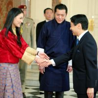 Special guests: Crown Prince Naruhito welcomes Bhutanese Queen Jetsun Pema as her husband, King Jigme Khesar Namgyel Wangchuck, looks on Friday at the State Guest House in Tokyo's Akasaka district. | KYODO