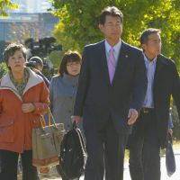 Seeking justice: Shizue Takahashi (left), who lost her husband in the 1995 sarin attack on the Tokyo subway system, and other relatives of victims head to the Supreme Court Monday morning to learn the fate of cult killer Seiichi Endo's appeal. | KYODO PHOTO