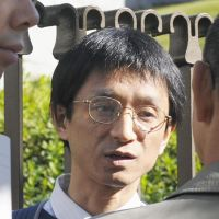 Spin control: Hiroshi Araki, spokesman for Aleph, a spinoff of Aum Shinrikyo, faces the media Monday in front of the Supreme Court.