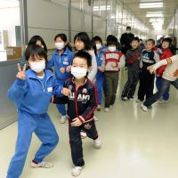 Together again: Students at Unosumai Elementary School in Kamaishi, Iwate Prefecture, gather in the hallway of their new temporary school building on Monday. | KYODO
