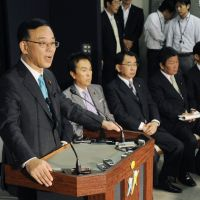 Hot-button issue: Prime Minister Yoshihiko Noda appears last week before the Lower House Budget Committee with Finance Minister Jun Azumi. | KYODO
