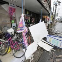 Stationary: Bicycles remain abandoned outside a shop in Okuma, a town in the no-go zone around the Fukushima No. 1 plant, on Friday, the first day the media were allowed to enter the town and neighboring Futaba since the March 11 disasters. | KYODO