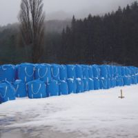 Chemistry project: Containers filled with contaminated soil are piled up on the grounds of a junior high school in the village of Kawauchi, Fukushima Prefecture, on Feb 23. | MIZUHO AOKI