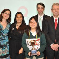 Spelling champ: Haruka Masuda (center), 2012 champion of the The Japan Times Spelling Bee, poses with judges Debra Hayama (left), Yukiko Ogasawara (second from left) and Edan Corkill (second from right), and pronouncer James Tschudy (right) at The Japan Times headquarters in Minato Ward, Tokyo, on Saturday. | YOSHIAKI MIURA