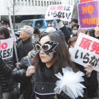 From tears to rage: Antinuclear protesters take to the streets of Tokyo on Sunday after holding a rally in Hibiya Park in Chiyoda Ward. | SATOKO KAWASAKI